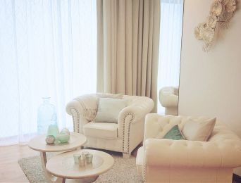 White leather chairs in office of modern decor. Elegant Interior design with gold and turqoise decoration.