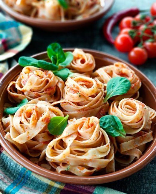 Italian local food culture. Pasta with basil and tomato sauce. Photo credit: sestrjevitovschii